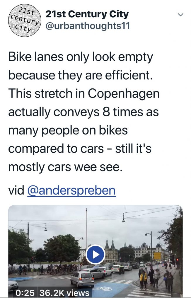 Tweet about how a bike lane is empty (while cars queue in their lane) in the photo but that's due to its high efficiency