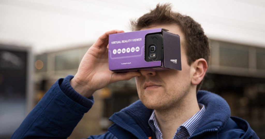 VR goggle system being held on face of user