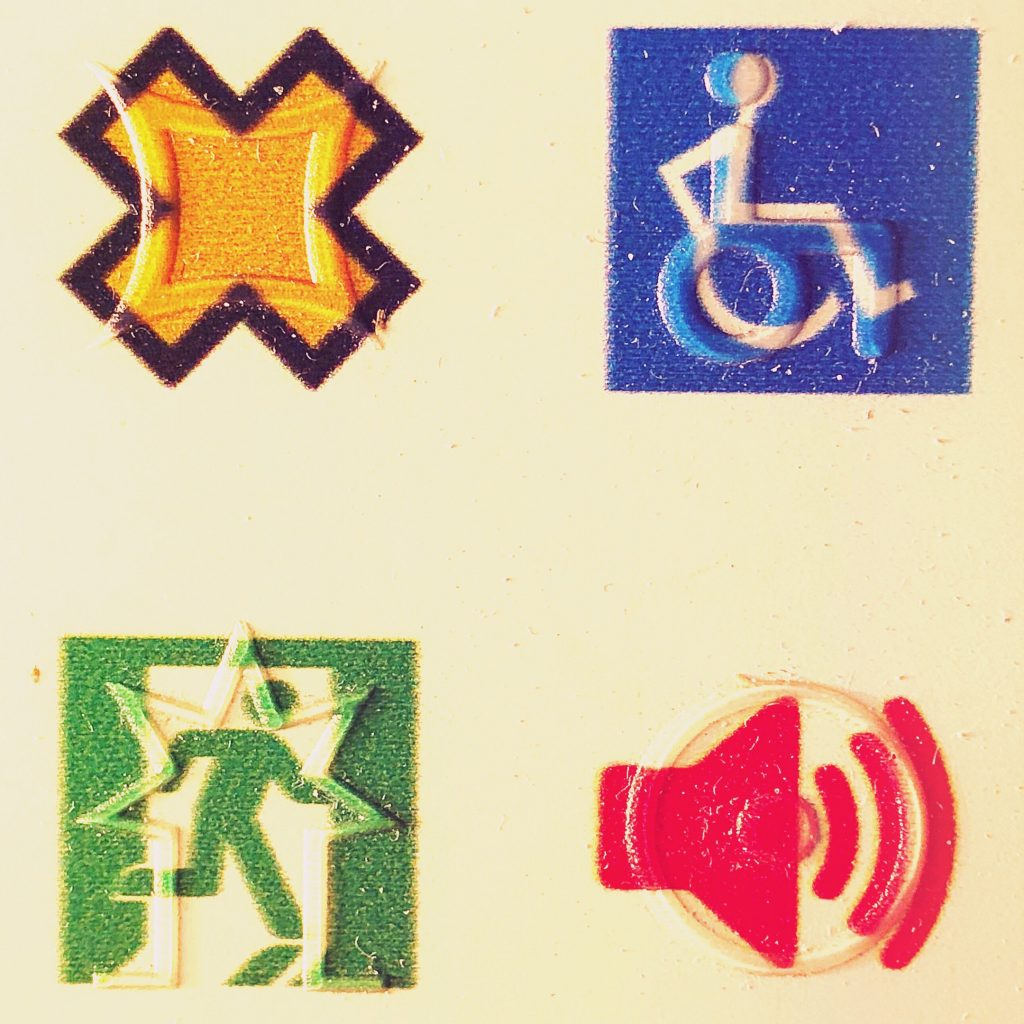 Sampler of tactile symbols for Fire Exit and Audio that are overlaid onto visual symbols