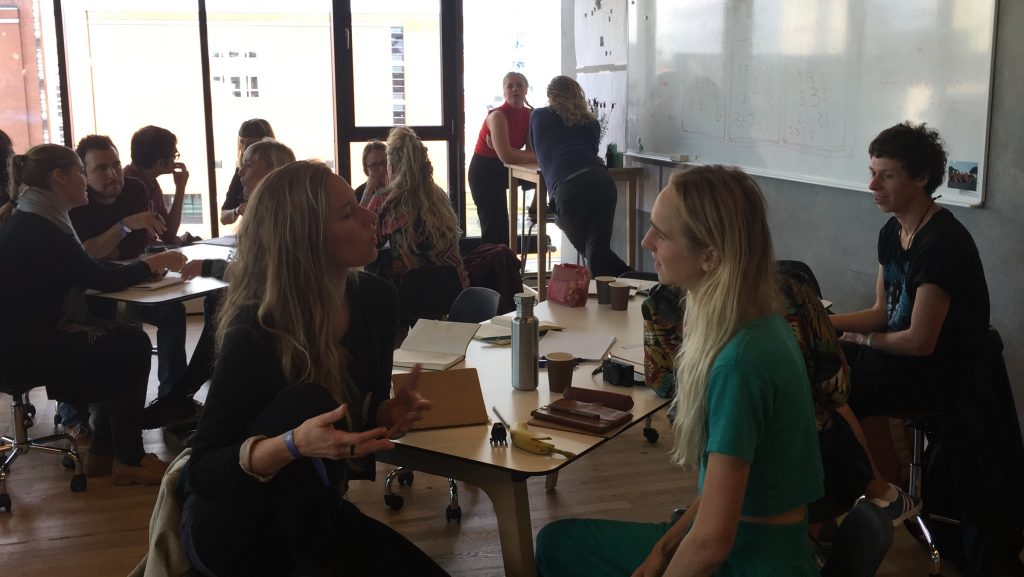 People talking to each other in a workshop room in Denmark